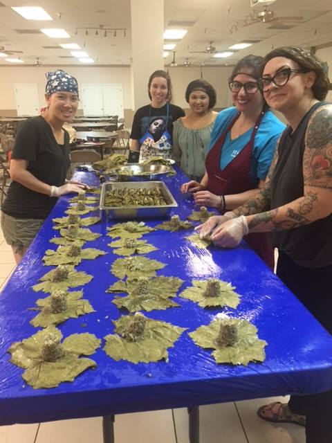 Volunteers making Dolmades